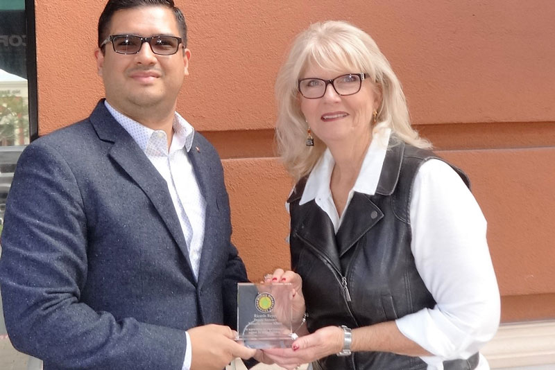 Debbie Nichols presenting MCCG Appreciation Award to Deputy Secretary of Minority Affairs Ricardo Reyes